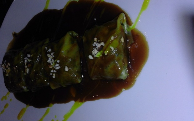 Oxtail Ravioli with Cauliflower Puree and a Port Wine Sauce.